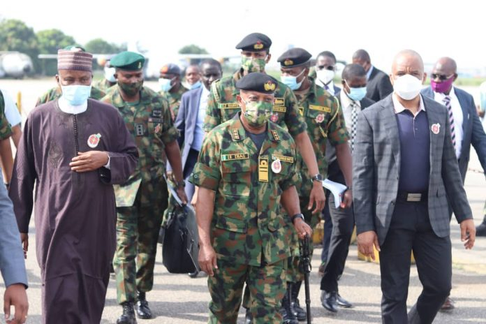 Minister of Defence, Maj Gen Bashir Salihi Magashi (rtd); Chief of Naval Staff, Vice Admiral Ibok Ekwe Ibas; and Director-General, Nigerian Maritime Administration and Safety Agency (NIMASA), Dr Bashir Jamoh, during an inspection of maritime security assets, in Lagos, on Thursday, November 19, 2020.